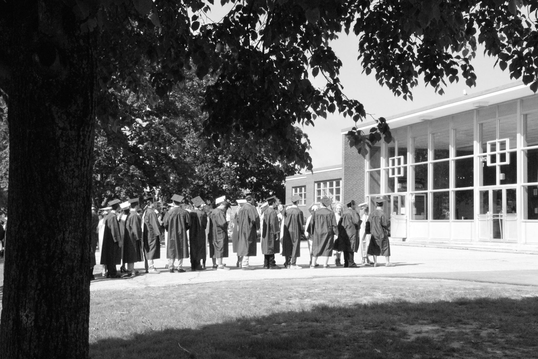 View of Linnell Gymnasium with graduating seniors